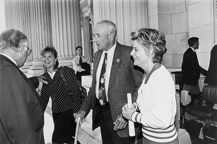 Rep. Michael Bilirakis, R-Fla., inviting Rep. Susan Molinari, R-N.Y., to join their Florida delegation group picture as Rep. William Lehman, D-Fla., and Rep. Ileana Ros-Lehtinen, R-Fla., look on Oct. 2, 1992. (Photo by Maureen Keating/CQ Roll Call)