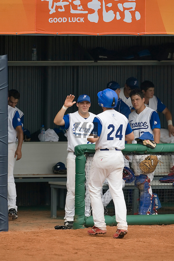 19 August 2007: Left Field #24 Gaspard Fessy is congratulated by his teammates during the Japan 4-3 victory over France in the Good Luck Beijing International baseball tournament (olympic test event) at the Wukesong Baseball Field in Beijing, China.