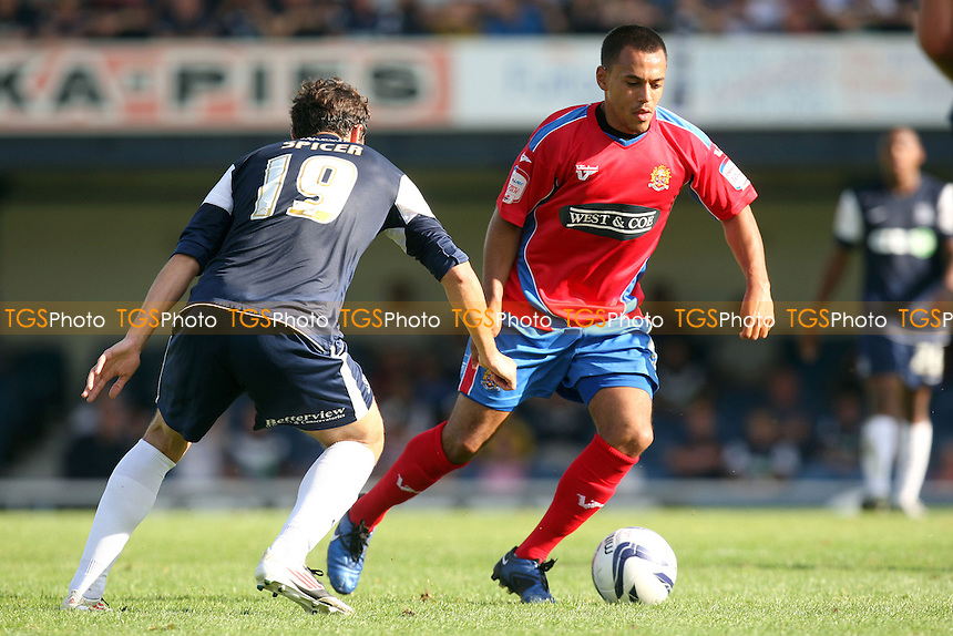Dominic Green of Dagenham and John Spicer of Southend United - Southend vs Dagenham at the London Borough of Roots Hall Stadium  - 08/09/12 - MANDATORY CREDIT: Dave Simpson/TGSPHOTO - Self billing applies where appropriate - 0845 094 6026 - contact@tgsphoto.co.uk - NO UNPAID USE.