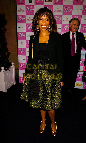 "TRISHA GODDARD.At the World Premiere of ""Dirty Dancing: The Classic Story On Stage"" Aldwych Theatre, London, England, .October 24th 2006..full length gold bag shoes green skirt black jacket.Ref: CAN.www.capitalpictures.com.sales@capitalpictures.com.©Can Nguyen/Capital Pictures"