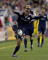 New England Revolution defender Darrius Barnes (25) traps the ball. In a Major League Soccer (MLS) match, the Columbus Crew defeated the New England Revolution, 3-0, at Gillette Stadium on October 15, 2011.
