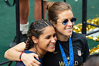 NEW YORK, NEW YORK - JULY 10: Kelley O'Hara #5 poses for a picture with a fan during the ticker tape parade for the 2019 FIFA Women's World Cup winning United States women's national soccer team at Canyon of Heroes on July 10, 2019 in New York, United States.