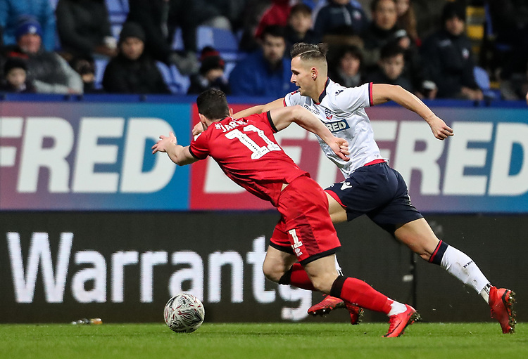 Bolton Wanderers' Pawel Olkowski competing with Walsall's Matt Jarvis <br /> <br /> Photographer Andrew Kearns/CameraSport<br /> <br /> Emirates FA Cup Third Round - Bolton Wanderers v Walsall - Saturday 5th January 2019 - University of Bolton Stadium - Bolton<br />  <br /> World Copyright © 2019 CameraSport. All rights reserved. 43 Linden Ave. Countesthorpe. Leicester. England. LE8 5PG - Tel: +44 (0) 116 277 4147 - admin@camerasport.com - www.camerasport.com