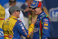 Mar 30, 2007; Martinsville, VA, USA; Nascar Nextel Cup Series driver Kyle Busch (5) talks with Bobby Labonte (43) during qualifying for the Goody's Cool Orange 500 at Martinsville Speedway. Martinsville marks the second race for the new car of tomorrow. Mandatory Credit: Mark J. Rebilas