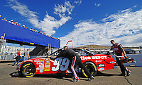 Nov. 9, 2008; Avondale, AZ, USA; The car of NASCAR Sprint Cup Series driver Carl Edwards is pushed through the garage prior to the Checker Auto Parts 500 at Phoenix International Raceway. Mandatory Credit: Mark J. Rebilas-