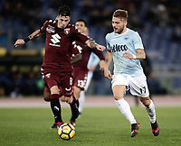 Calcio, Serie A: Roma, stadio Olimpico, 11 dicembre 2017.<br /> Torino's Daniele Baselli (l) in action with Lazio's Ciro Immobile (r) during the Italian Serie A football match between Lazio and Torino at Rome's Olympic stadium, December 11, 2017.<br /> UPDATE IMAGES PRESS/Isabella Bonotto