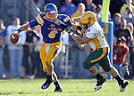 BROOKINGS, SD - SEPTEMBER 28:   Austin Sumner #6 from South Dakota State University tries to escape the grasp of Grant Olson #34 from North Dakota State University in the fourth quarter of their game Saturday afternoon at Coughlin Alumni Stadium in Brookings. (Photo by Dave Eggen/Inertia)