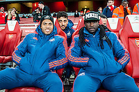 Kyle Bartley, Neil Taylor Marvin Emnes and Leon Britton of Swansea City ( behind emnes ) sit on the bench prior to the Barclays Premier League match between Arsenal and Swansea City at the Emirates Stadium, London, UK, Wednesday 02 March 2016