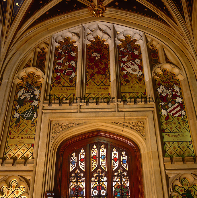 A door at the top of the main staircase is surrounded by coats of arms of Admirals and Field Marshalls