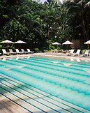 SINGAPORE, Ritz Carlton Hotel, swimming pool with lounge chair in Ritz Carlton hotel