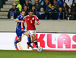 Bosnia-Herzegovina's Senad Lulic (L) fights for the ball with Egypt's Ahmed El Mohamady (R) during a FIFA World Cup 2014 friendly football match between Bosnia-Herzegovina and Egypt at the Tivoli Stadium, in Innsbruck on March 5, 2014. PHOTO / PIERRE TEYSSOT