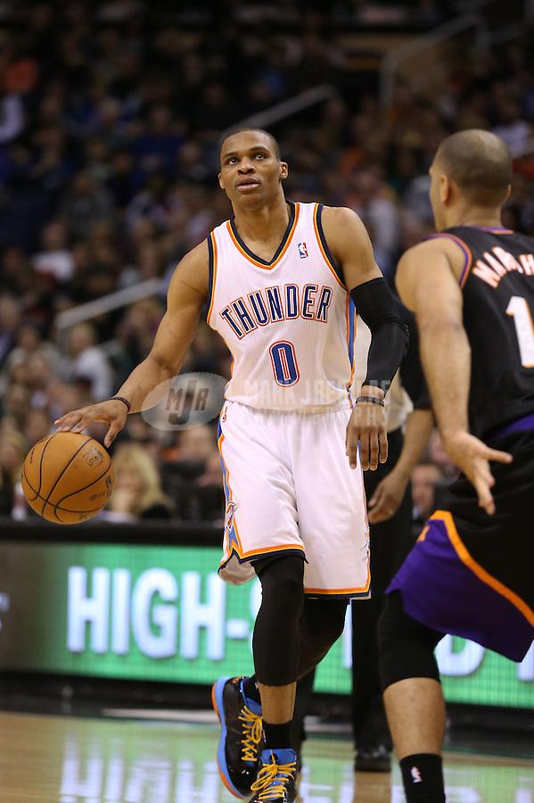 Feb. 10, 2013; Phoenix, AZ, USA: Oklahoma City Thunder point guard Russell Westbrook against the Phoenix Suns at the US Airways Center. Mandatory Credit: Mark J. Rebilas-