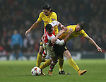 Arsenal's Alexis Sanchez tussles with Dortmund's Neven Subotic and Kevin Grosskreutz<br /> <br /> UEFA Champions League- Arsenal vs Borussia Dortmund- Emirates Stadium - England - 26th November 2014 - Picture David Klein/Sportimage