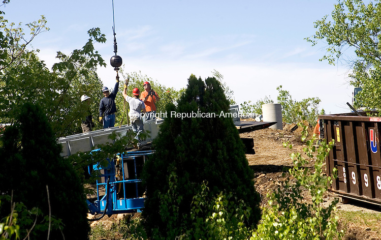 WATERBURY, CT- 28 MAY 2008- 052808JT08-<br /> Workers reach for the hook for a crane as they erect the new cross at Holy Land on Pine Hill in Waterbury on Wednesday.<br /> Josalee Thrift / Republican-American