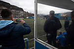 The home bench watch the action during the second-half as Cambrian and Clydach Vale (in blue) take on Cwmbran Celtic at King George's New Field in a Welsh League Division One match, the top division of the Welsh Football League and the second level of the Welsh football league system. The club, formed in 1965 reached the final of the 2018-19 League Cup final and can count on ex-England manager Terry Venables as a former club chairman. Cambrian and Clydach Vale won this match 2-0, watch by a crowd of around 100 spectators.