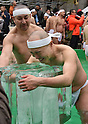 January 8, 2017, Tokyo, Japan - A half-naked man holds on to a block of solid ice added to already freezing cold water during a new years annual rite in downtown Tokyo on a cold Sunday of January 8, 2017. Practitioners of Shinto, a Japanese ethnic religion focusing on ritual practices to be carried out diligently, immerse themselves in icy water under the frigid temperatures, which was believed to cleanse the spirit or just to show off their bravery and endurance. (Photo by Natsuki Sakai/AFLO) AYF -mis-