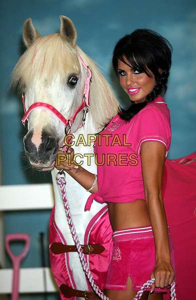 KATIE PRICE - JORDAN.Launched her new range of Equestrian Wear at Holburn Studios, London, England. She will be riding in dressage at Burghley Horse Trials on Friday and has launched her new company KP Equestrian..September 3rd, 2008.half length horse animal braids plaits pink knotted top shorts belly stomach midriff lipstick .CAP/DS.©Dudley Smith/Capital Pictures