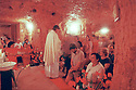 Fr Peter Bourke at Easter Sunday mass, St Peter & St Paul Catholic Church, underground. Coober Pedy, South Australia