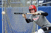 Batavia Muckdogs outfielder Ryan Aper (3) lays down a bunt during practice on June 10, 2014 at Dwyer Stadium in Batavia, New York.  (Mike Janes/Four Seam Images)