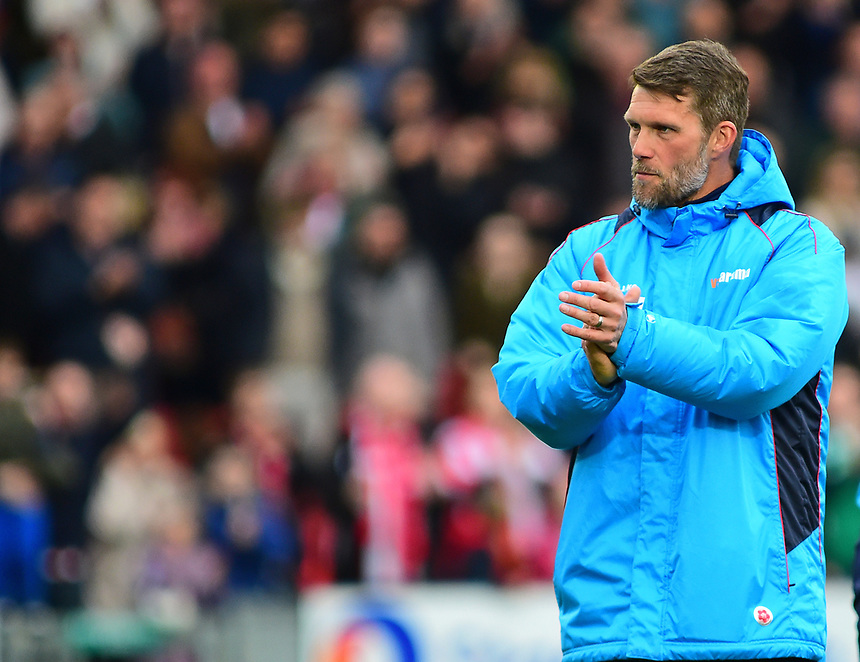 Lincoln City's goalkeeping coach Jimmy Walker applauds the fans at the end of the match<br /> <br /> Photographer Andrew Vaughan/CameraSport<br /> <br /> Vanarama National League - Lincoln City v Torquay United - Friday 14th April 2016  - Sincil Bank - Lincoln<br /> <br /> World Copyright &copy; 2017 CameraSport. All rights reserved. 43 Linden Ave. Countesthorpe. Leicester. England. LE8 5PG - Tel: +44 (0) 116 277 4147 - admin@camerasport.com - www.camerasport.com