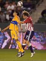 Tigres de UANL defender Alan Rangel battles Chivas USA defender Carey Talley. Los Tigres de UANL defeated the Chivas USA 2-1 during a 2009 SuperLiga match at Home Depot Center stadium in Carson, California on Saturday evening June 20, 2009.   .