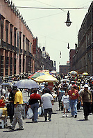 Crowds of people on Calle Moneda in the Centro Historico, Mexico City