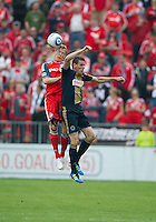 Philadelphia Union midfielder Sebastien Le Toux #9 and Toronto FC defender Ty Harden #20 in action during an MLS game between the Philadelphia Union and the Toronto FC at BMO Field in Toronto on May 28, 2011..The Philadelphia Union won 6-2..