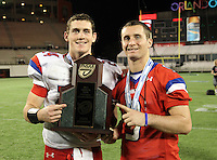 Manatee Hurricanes quarterback Cord Sandberg #24 and brother, wide receiver Chase Sandberg #9 who did not play due to injury, pose with the Championship trophy after the Florida High School Athletic Association 7A Championship Game at Florida's Citrus Bowl on December 16, 2011 in Orlando, Florida.  Manatee defeated First Coast 40-0.  (Mike Janes/Four Seam Images)