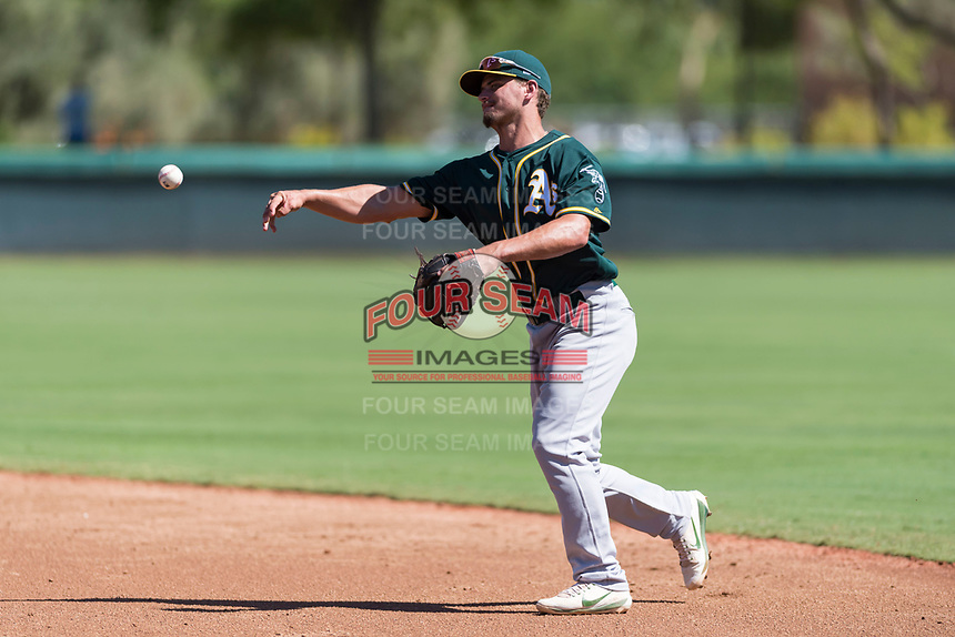 Oakland Athletics second baseman Jeremy Eierman (10) throws to first base during an Instructional League game against the Los Angeles Dodgers at Camelback Ranch on September 27, 2018 in Glendale, Arizona. (Zachary Lucy/Four Seam Images)