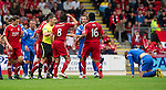 St Johnstone v Aberdeen...21.08.10  .Ref Steven McLean separates the players after Paul Hartley's foul on Murray Davidson.Picture by Graeme Hart..Copyright Perthshire Picture Agency.Tel: 01738 623350  Mobile: 07990 594431