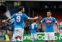 Napoli's Gonzalo Higuain celebrateswith teammate  Marek Hamsik  after scoring during the  italian serie a soccer match,between SSC Napoli and Empoli      at  the San  Paolo   stadium in Naples  Italy , January 31, 2016