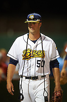 Burlington Bees pitcher Austin Young (50) walks to the dugout after a game against the Clinton LumberKings on August 20, 2015 at Community Field in Burlington, Iowa.  Burlington defeated Clinton 3-2.  (Mike Janes/Four Seam Images)