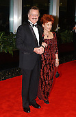 Robert Goulet and his wife, Vera Novak, arrive for a dinner hosted by United States Secretary of State Colin Powell celebrating the 2001 Kennedy Center Honorees Van Cliburn, Julie Andrews, Jack Nicholson, Quincy Jones, and Luciano Pavarotti at the U.S. Department of State in Washington, D.C. on Saturday, December 1, 2001..Credit: Ron Sachs / CNP