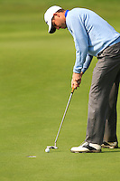 David Howell (ENG) takes his putt on the 9th green during Sunday's Final Round of the 2014 BMW Masters held at Lake Malaren, Shanghai, China. 2nd November 2014.<br /> Picture: Eoin Clarke www.golffile.ie