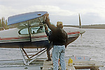 Unloading for a day of fishing from a Gogama Lodge Float-Plane on small un-named lake in Northern Ontario, Canada
