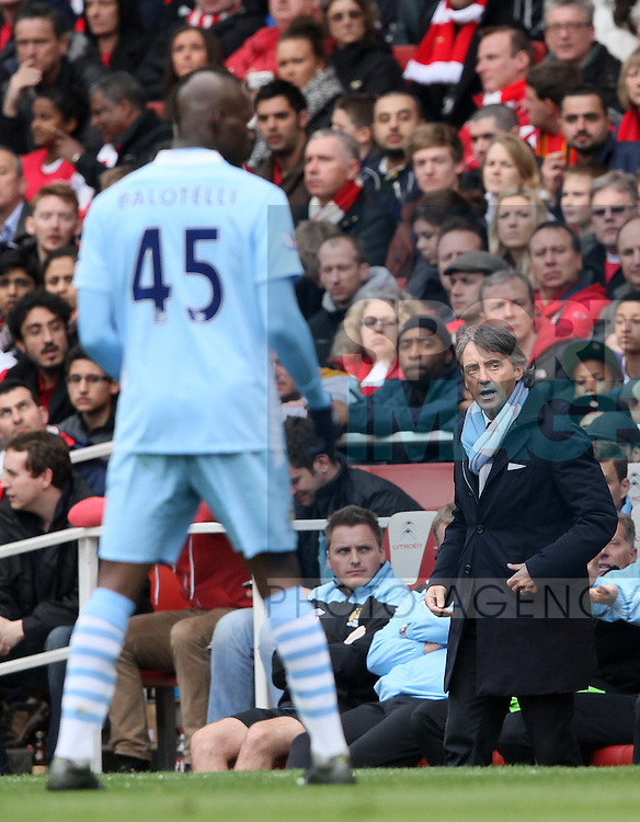 Manchester Citys Roberto Mancini watches Mario Balotelli..Arsenal v Manchester City, Barclays Premier League, at the Emirates, London. 8th April 2012.--------------------.Sportimage +44 7980659747.picturedesk@sportimage.co.uk.http://www.sportimage.co.uk/.Editorial use only. Maximum 45 images during a match. No video emulation or promotion as 'live'. No use in games, competitions, merchandise, betting or single club/player services. No use with unofficial audio, video, data, fixtures or club/league logos.