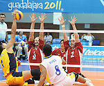 November 18 2011 - Guadalajara, Mexico:  Austin Hinchey and Mikael Bartholdy of Team Canada are set to block while taking on Columbia in the Bronze Medal Game in the Pan American Volleyball Complex at the 2011 Parapan American Games in Guadalajara, Mexico.  Photos: Matthew Murnaghan/Canadian Paralympic Committee