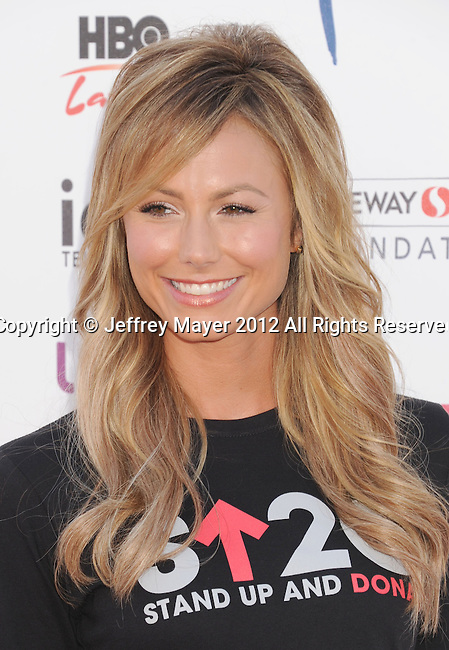 LOS ANGELES, CA - SEPTEMBER 07: Stacy Keibler arrives at Stand Up To Cancer at The Shrine Auditorium on September 7, 2012 in Los Angeles, California.