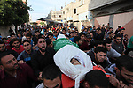 Palestinian mourners carry the body of Mohammed al-Radee, 25, who was killed in Israeli tank fire during his funeral, in Beit Lahia in the northern of Gaza Strip on May 28, 2018. Photo by Mahmoud Ajour