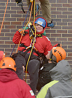 NWA Democrat-Gazette/BEN GOFF @NWABENGOFF<br /> Jacqueline Bettis, a Sunshine School &amp; Development Center adult client, rappels with Over the Edge technical coordinator Todd Medeiros Saturday, March 11, 2017, during the Sunshine School &amp; Development Center's rappelling fundraiser with Over The Edge at the 8W Center in Bentonville. The school began a campaign in January, with participants who reached their fundraising goal able to participate in rappelling from the roof of the 6-story building. Over the Edge is a company which specializes in producing events for non profits using equipment and techniques used in commercial rope-access work such as sign installation and window washing. The event had raised more than $57,000 for the school, with more donations still coming in Saturday morning. Located in Rogers, the Sunshine School &amp; Development Center serves children and adults with developmental dissabilities, including a preschool.