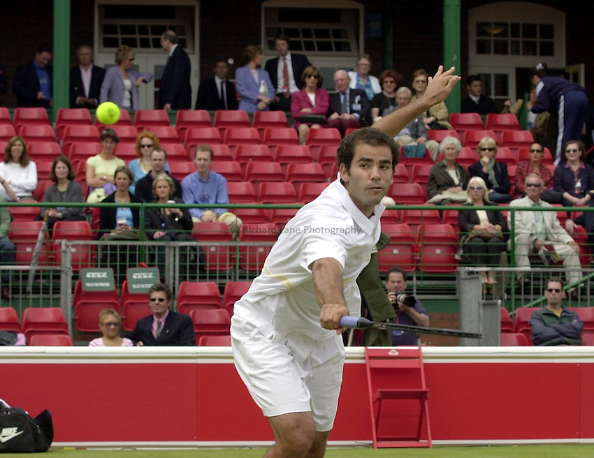 Photo:Ken Brown .11/06/2001. .Stella Artois Championship 2001 .Pete Sampras plays a volley in a half empty center court in his match against Jan Siemerink which was carried over from yesterday.