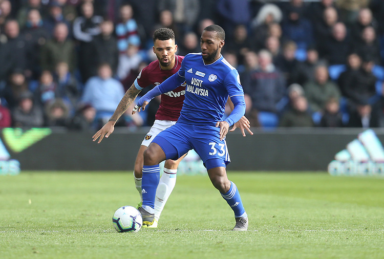 Cardiff City's Junior Hoilett and West Ham United's Ryan Fredericks<br /> <br /> Photographer Rob Newell/CameraSport<br /> <br /> The Premier League - Cardiff City v West Ham United - Saturday 9th March 2019 - Cardiff City Stadium, Cardiff<br /> <br /> World Copyright © 2019 CameraSport. All rights reserved. 43 Linden Ave. Countesthorpe. Leicester. England. LE8 5PG - Tel: +44 (0) 116 277 4147 - admin@camerasport.com - www.camerasport.com