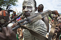 Ethiopia. Southern Nations, Nationalities, and Peoples' Region. Omo Valley. Korcho Village. Kara tribe. Omo river. Agro-pastoralist group. The Kara men are best known for the elaborate body painting they indulge in before important ceremonies. They paint their faces and bodies in white chalk and pierce their ears in five places. Scarification plays an important role in Kara body decoration. Every man carries a wooden headrest which doubles as a stool. The AK-47 (also known as the Kalashnikov, AK, or Kalash) is a selective-fire (semi-automatic and automatic) assault rifle. The Omo Valley, situated in Africa's Great Rift Valley, is home to an estimated 200,000 indigenous peoples who have lived there for millennia. Amongst them are 1,000 to 2,000 Karo who dwell on the eastern banks of the Omo river. Southern Nations, Nationalities, and Peoples' Region (often abbreviated as SNNPR) is one of the nine ethnic divisions of Ethiopia. 8.11.15 © 2015 Didier Ruef