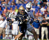 Tom Montelli (11) of Duke defends Grant Krebs (12) of Notre Dame during the NCAA Men's Lacrosse Championship held at M&T Stadium in Baltimore, MD.  Duke defeated Notre Dame, 6-5, to win the title in overtime.