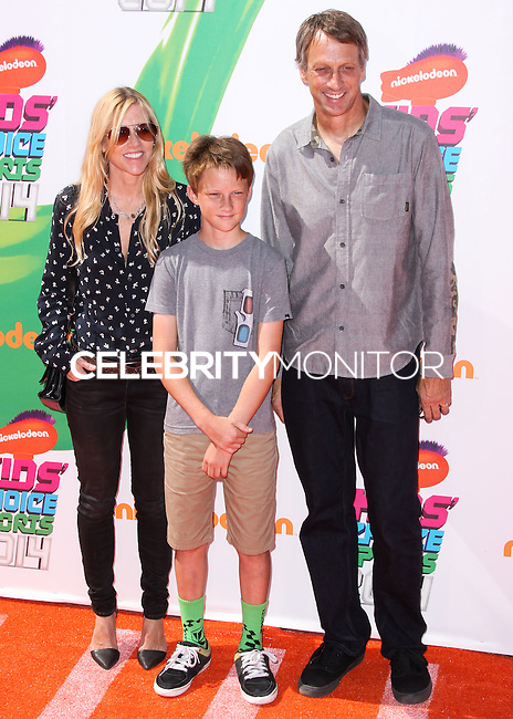 WESTWOOD, LOS ANGELES, CA, USA - JULY 17: Tony Hawk, Cathy Goodman, Keegan Hawk at the Nickelodeon Kids' Choice Sports Awards 2014 held at UCLA's Pauley Pavilion on July 17, 2014 in Westwood, Los Angeles, California, United States. (Photo by Xavier Collin/Celebrity Monitor)
