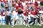 North Carolina State Wolfpack quarterback Ryan Finley (15) drops back to pass during first half action against the South Carolina Gamecocks in the Belk College Kickoff at Bank of America Stadium on September 2, 2017 in Charlotte, North Carolina.  The Gamecocks defeated the Wolfpack 35-28.  (Brian Westerholt/Sports On Film)