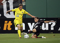 7 May 2005.  DC United's Ben Olsen (14) tackles the ball away from Domenic Mediate (28) of Columbus at RFK Stadium in Washington, DC.