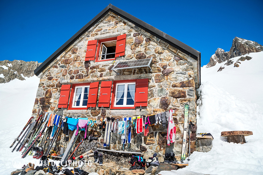 Ski touring gear sits outside the Trift Hut to dry in the sun, Switzerland