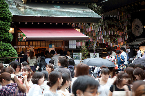 July 7, 2012, Tokyo, Japan - In the rain visitors come to pray that their wishes come true at Tokyo Daijingu Shrine in Tanabata festival on July 7th. The annual celebration of Tanabata in Japan has been held since the Edo era. It celebrates the meeting of two lovers Orihime and Hikoboshi, according to legend that Milky Way separates these lovers, and may only meet once a year on the seventh day of the seventh month of calendar. (Photo by Rodrigo Reyes Marin/AFLO)