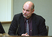 Larry Meyers, brother of sniper victim Dean H. Meyers, testifies during the penalty phase of the trial of convicted sniperJohn Allen Muhammad in Virginia Beach Circuit Court in Virginia Beach, Virginia on November 19, 2003.  Now in the punishment phase of the trial, the jury can only choose execution or life in prison without parole for Muhammad, who was found guilty Monday, November 17, 2003 of all charges, including two capital murder counts, in one of 10 fatal shootings that terrorized the Washington, D.C., area in 2002.  <br /> Credit: Tracy Woodward - Pool via CNP